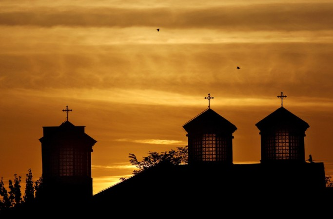 Sunsets behind an Orthodox church on a warm autumn day in Kosovo.